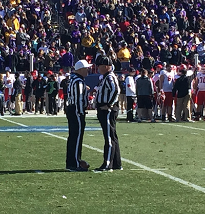 Judge Self with Dr. Marshall Lewis, the referee assigned to the game.
